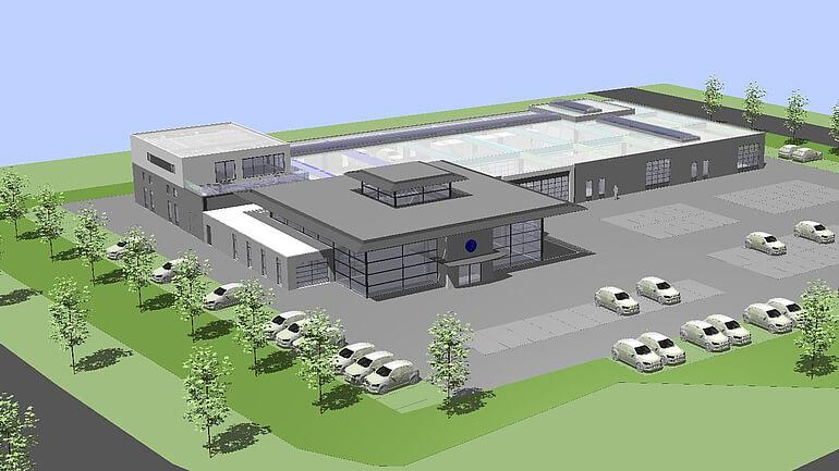 Außenansicht eines KFZ Werkstatt-Gebäudes mit Grünfläche und Parkplätzen