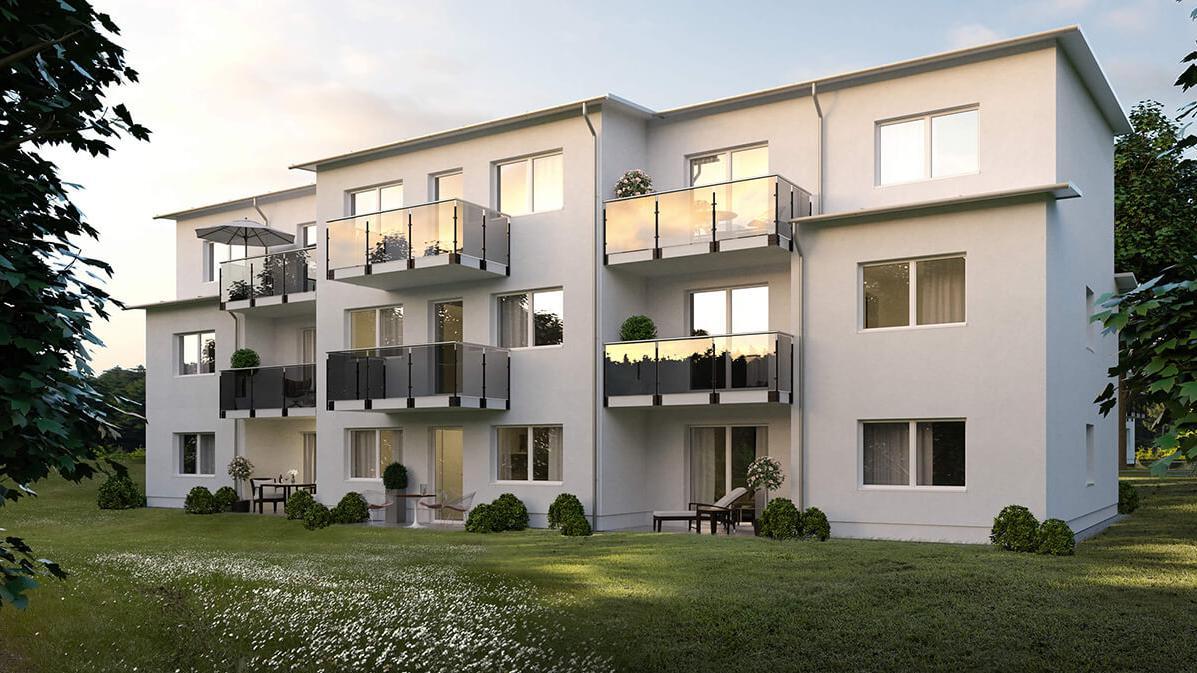 Moderner Geschosswohnungsbau mit vielen Balkonen und großem Garten